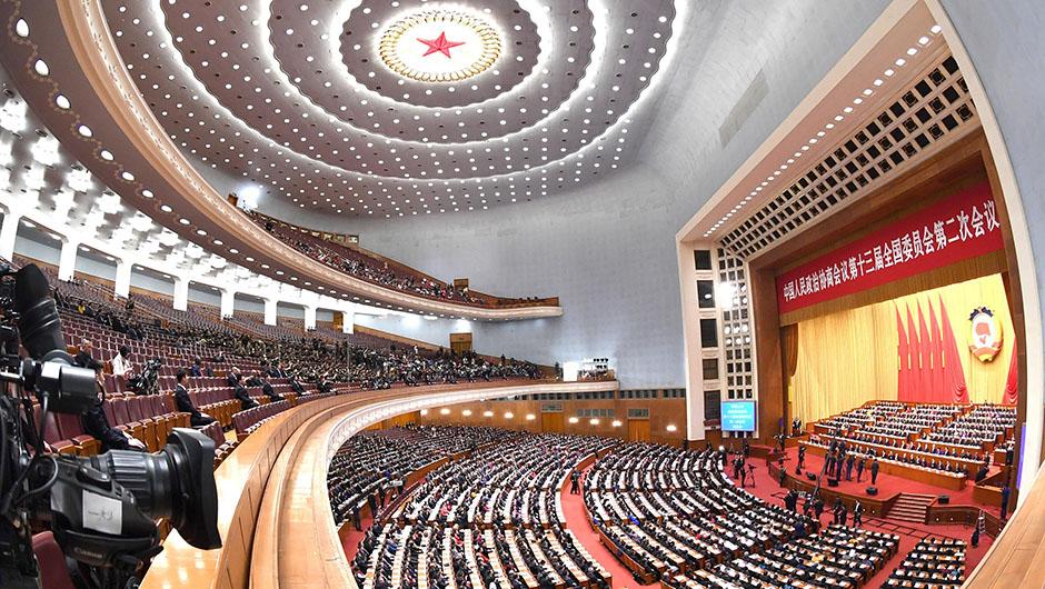 新华社照片,北京,2019年3月13日     全国政协十三届二次会议闭幕????      3月13日,中国人民政治协商会议第十三届全国委员会第二次会议在北京人民大会堂举行闭幕会。     新华社记者 饶爱民 摄